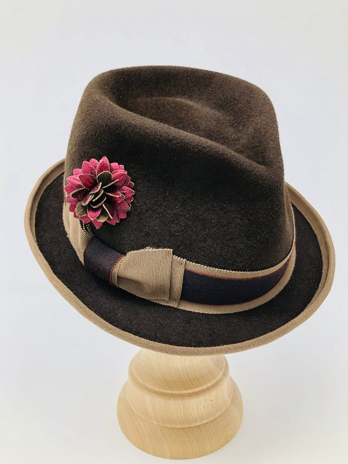 Curled Stingy Brim shown with leather flower, artisan hat maker Laurie Berliner of Madge & Me